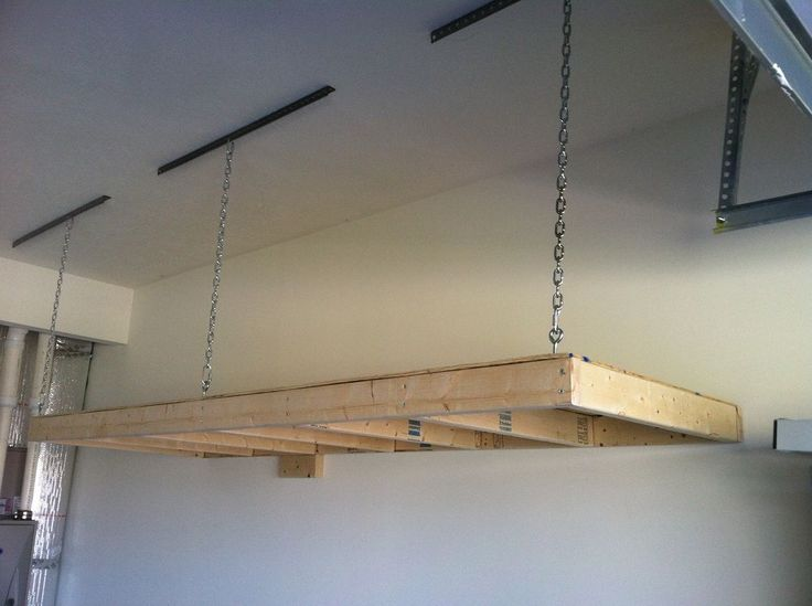 25 best ideas about overhead garage storage on pinterest for Over car garage storage