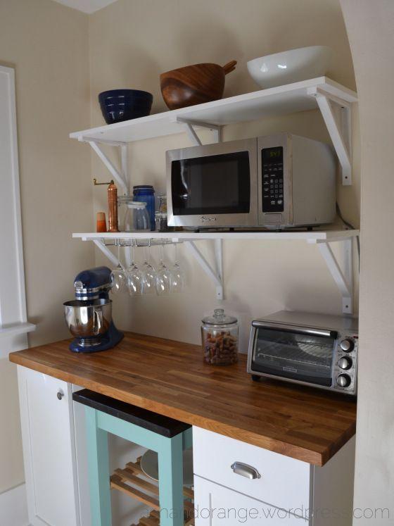 Microwave on shelf with Ikea Ekby Valter brackets. Wine glass rack under shelf.