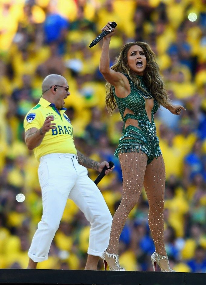 Singers Pitbull (L) and Jennifer Lopez perform during the Opening Ceremony#brazil#2014#worldcup