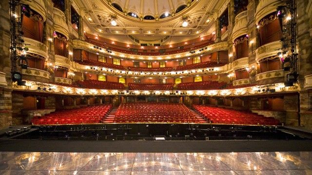 The view from the stage: the auditorium of the London Coliseum. Seating is spread over 4 levels, the Stalls, Dress Circle, Upper Circle and Balcony.  The auditorium has approximately 2,350 seats, making it the biggest theatre in London.