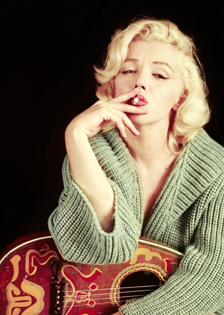 Marilyn Monroe. Mandolin sitting. Photo by Milton Greene, 1953.