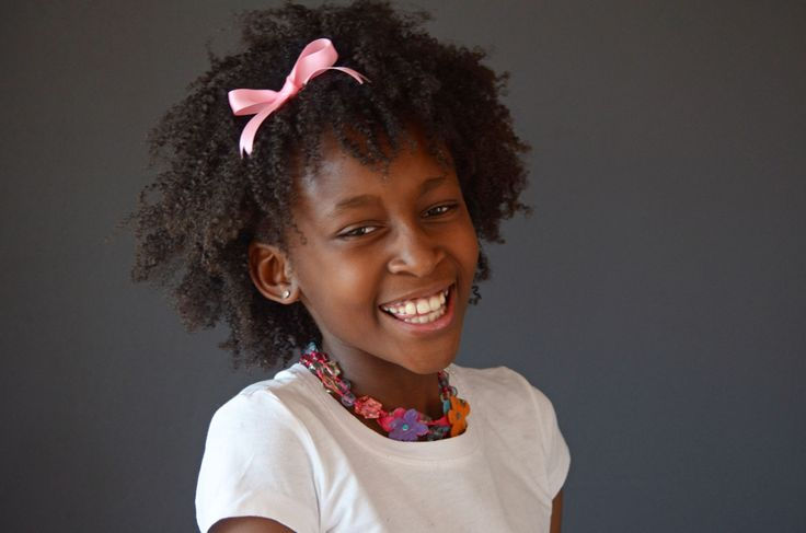 Add a cute bow to your daughter's natural hair.