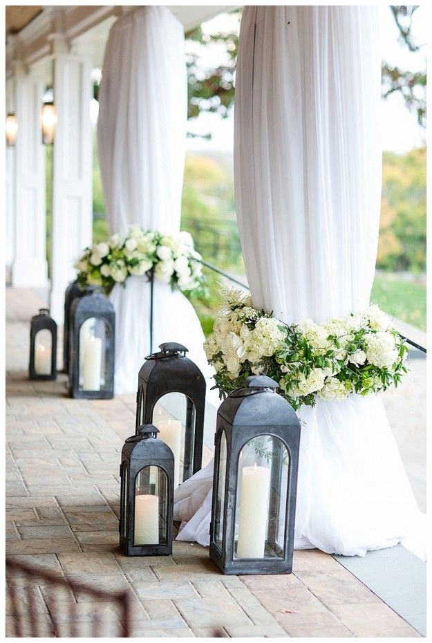 Dreamy lanterns with lush white florals. Floral design: Winston Flowers.