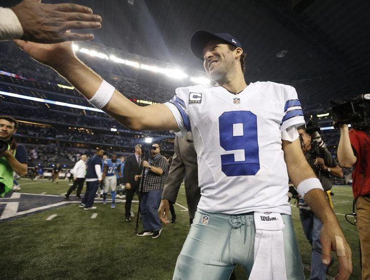 Dallas Cowboys quarterback Tony Romo (9) celebrates after an NFL wildcard playoff football game against the Detroit Lions, Sunday, Jan. 4, 2015, in Arlington, Texas. The Cowboys won 24-20. (AP Photo/Brandon Wade)