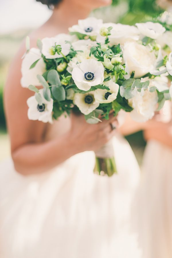 anemones and eucalyptus, photo by Lisa Poggi http://ruffledblog.com/tuscany-destination-wedding #bouquets #flowers #weddingbouquet