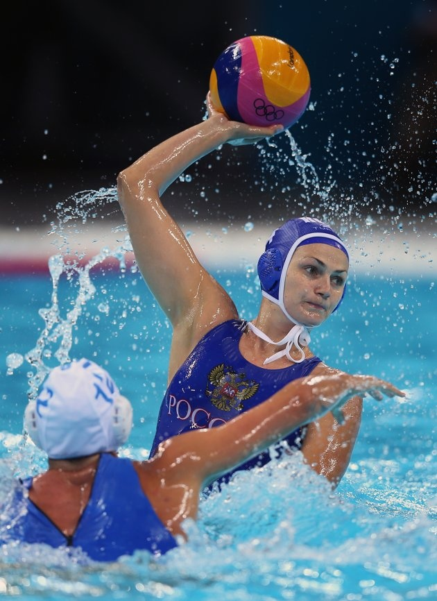 AUGUST 01: Sofya Konukh of Russia is blocked by Diana Antonova of Italy on Day 5 of the London 2012 Olympics at Water Polo Arena on August 1, 2012 in London, England. (Photo by Jeff J Mitchell/Getty Images)