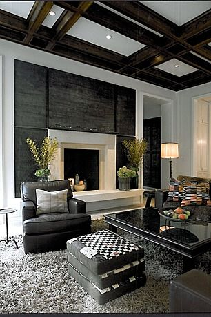 Beautiful way to create a dramatic fireplace surround and focal point in a room