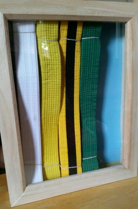 DIY karate belt display in a unfinished shadow box. Stain, add medals and photos at later date.