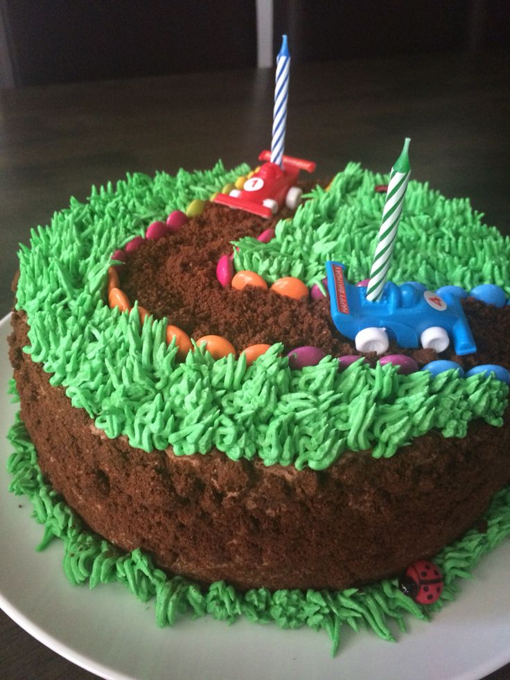 Racing car themed birthday cake made by me.