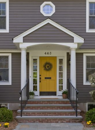 Speaking of... Grey Siding with yellow door brick steps help the look. Maybe stain our concrete steps?
