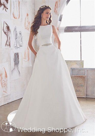 A modest satin wedding dress with a high neckline.