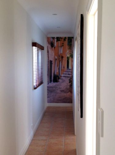 Lisa, VIC, recently installed this wall mural of a small French street at the end of her hallway in Seaford. She wanted to give the impression that the hallway led into the picturesque street so cropped it accordingly. What do you think?!