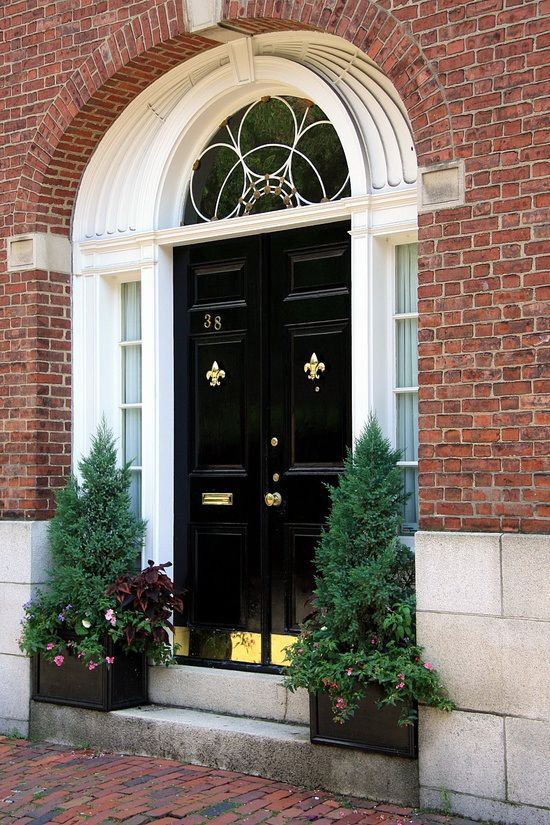 These Glossy Black Double Front Doors Make A Striking Contrast With The  White Trim And Brass