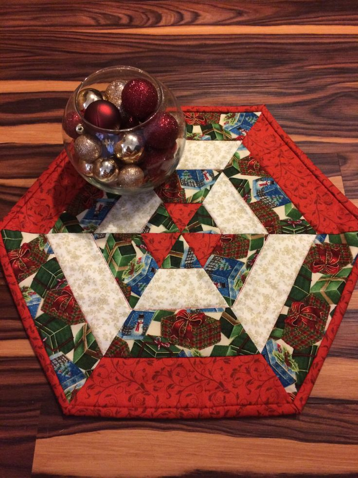 Quilted Christmas Presents Centerpiece Table Topper Runner by Heathersquaintquilts on Etsy https://www.etsy.com/listing/201162555/quilted-christmas-presents-centerpiece