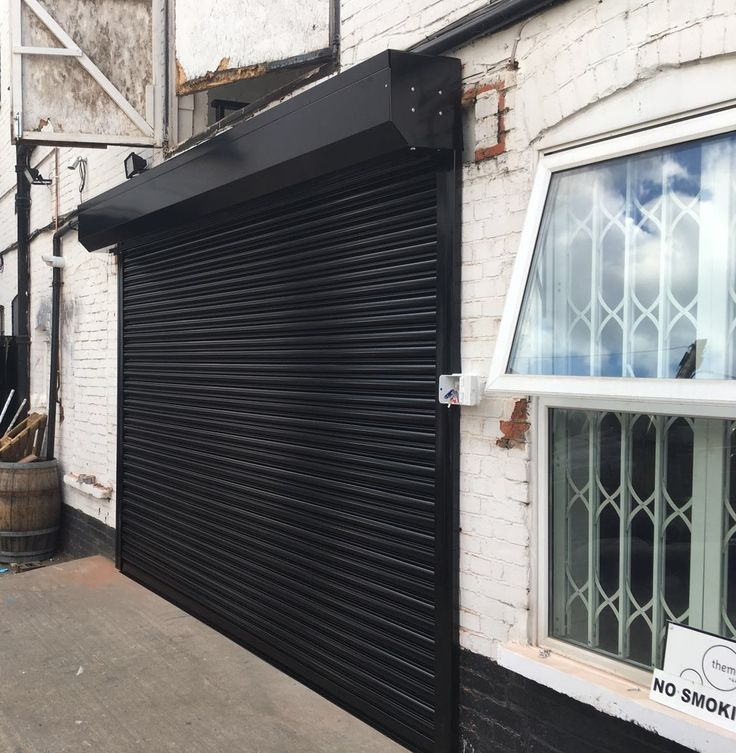 Securing your business premises with our RSG5000 galvanised steel shutter is the best option so far; previous installation of our shutter,powder coated black, to a commercial unit in North West London.