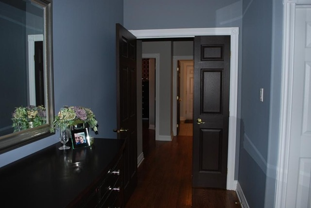 the dark doors with white trim