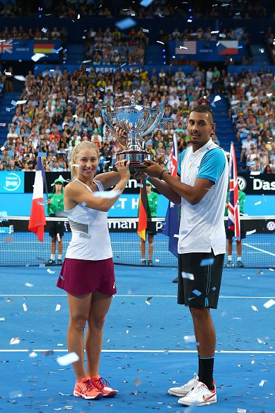 Daria Gavrilova and Nick Kyrgios of Australia Green pose with the Hopman Cup after winning the final against Elina Svitolina and Alexandr Dolgopolov...