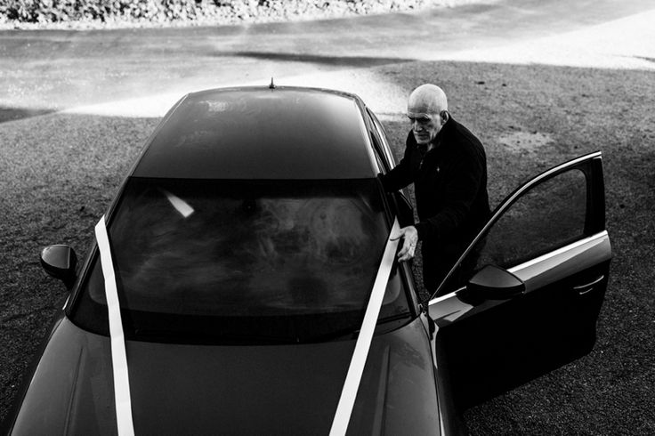 Getting the wedding car ribbons just right. Photo by Benjamin Stuart Photography #weddingphotography #weddingcar #carribbons #blackandwhite #weddingtransport #fatherofthebride