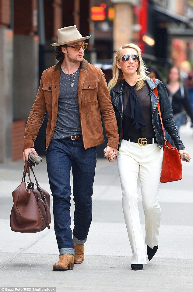 Loved up: Sam Taylor-Johnson and her husband Aaron enjoyed a romantic stroll through New Y...