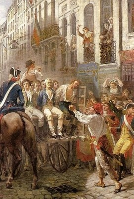 A wooden tumbril carries prisoners from their jails to the scaffold.  French Revolution.
