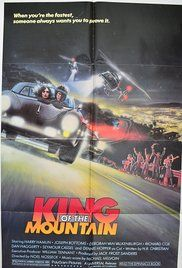King Of The Mountain Movie 1981. A group of friends race their high-powered cars up and down a dangerous and deadly mountain road known as Mulholland Drive to see who can claim the title of King of the Hill.