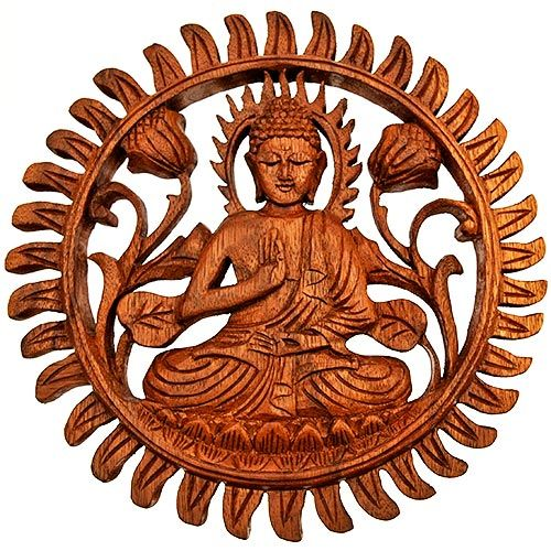 """An impressive Wooden Buddha Wall Plaque hand carved for Sunlover (a BAFTS importer) by skilled members of a workers co-operative in Sukawati, Bali. The Buddhas are carved from The Indian Rain Tree, known locally as """"Suar"""" wood, which is not indigenous to the region, but was originally introduced by the Dutch, and is plantation grown.  Suar wood has been extensively used for larger carvings due to its strength and crossed grain.  Diameter : 250mm Thickness : 20mm"""