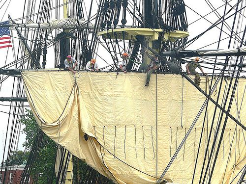 images of a ship's yard the horizonal spar from which a square sail is suspended | Yardarm definition/meaning