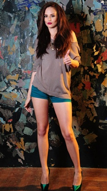 on Georgina Wilson: long-sleeved flat knit top + colored shorts | bench/