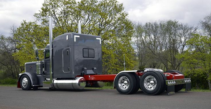 Gray and red long wheel base (stretched) Peterbilt.