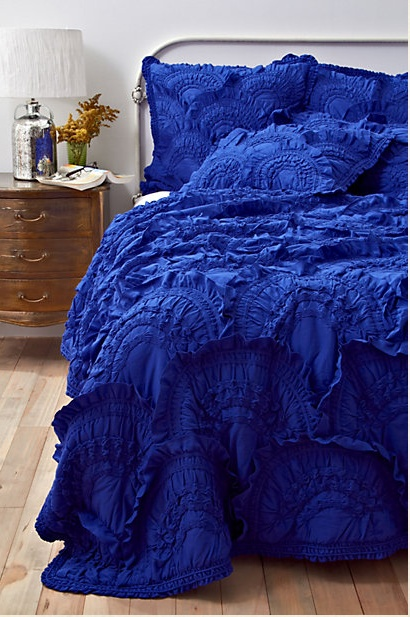 anthropologie cobalt blue bedding...love how it brings deep rich color to the room.