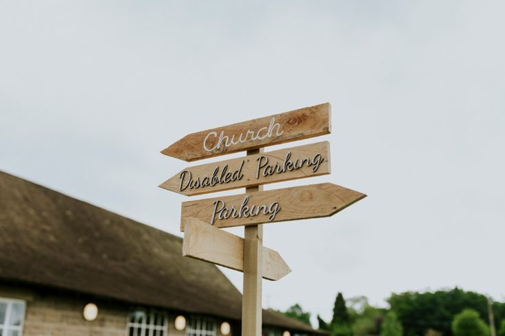 Make sure your guests know where the important things are with gorgeous signs like these. Photo by Benjamin Stuart Photography #weddingphotography #weddingsigns #signage #signpost #weddingday #directions