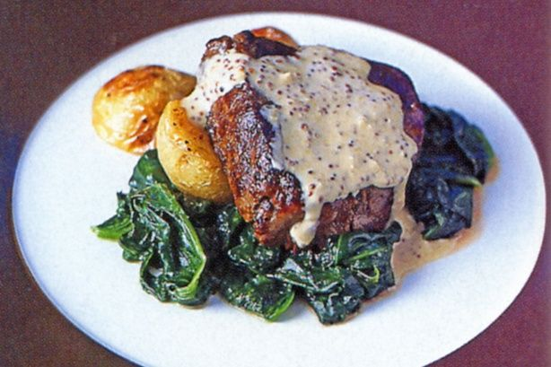 Brandy sauce adds decadence to this tasty steak and vegetable dinner.