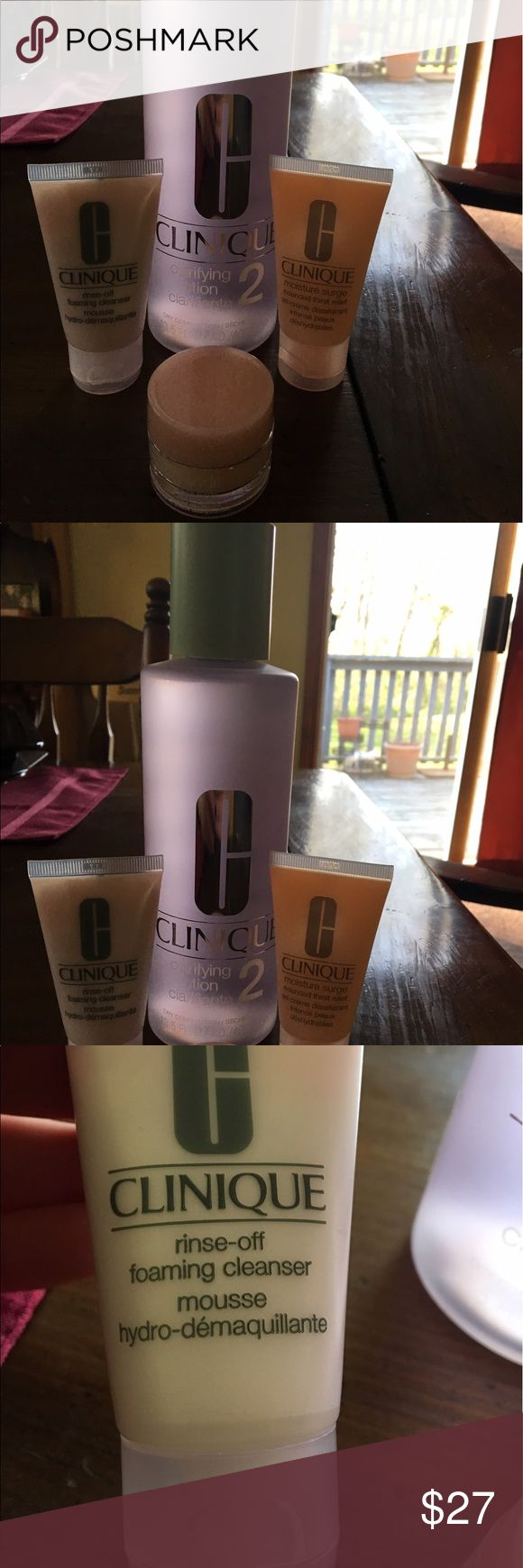 Clinique four piece skincare set One 13.5 fluid oz Step 2 clarifying lotion; one travel size moisture surge extended thirst relief; one travel size rinse-off foaming cleanser mousse; and one mini jar of moisture surge extended thirst relief. Never opened. Never used. Just received these this week so brand new. FREE makeup bag with purchase!! Make an offer! Clinique Makeup