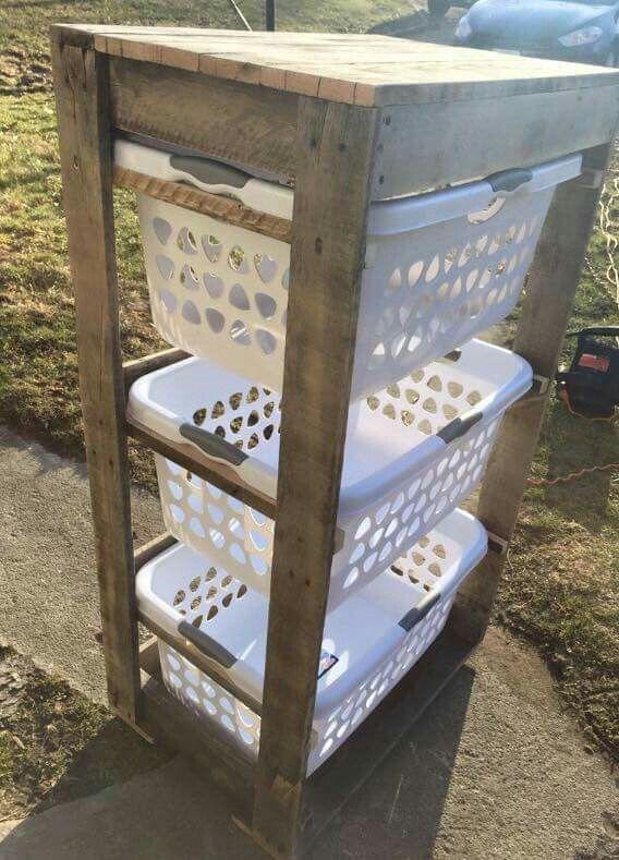 DFI hamper. Holds 3 laundry baskets. Made of pallets!