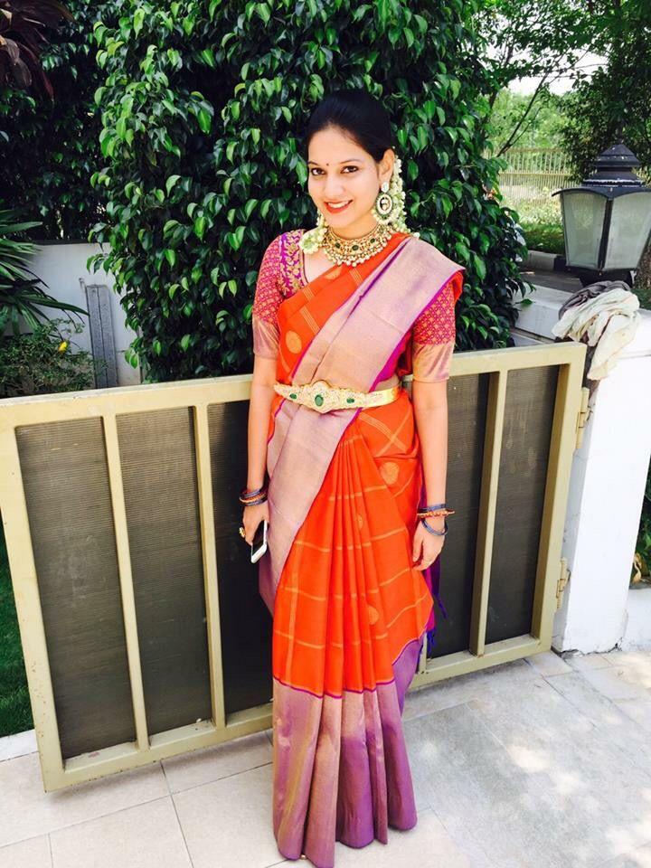 South Indian bride. Diamond kundan Indian bridal  jewelry. Jhumkis.Orange kanchipuram sari.Braid with fresh jasmine flowers. Tamil bride. Telugu bride. Kannada bride. Hindu bride. Malayalee bride.Kerala bride.South Indian wedding