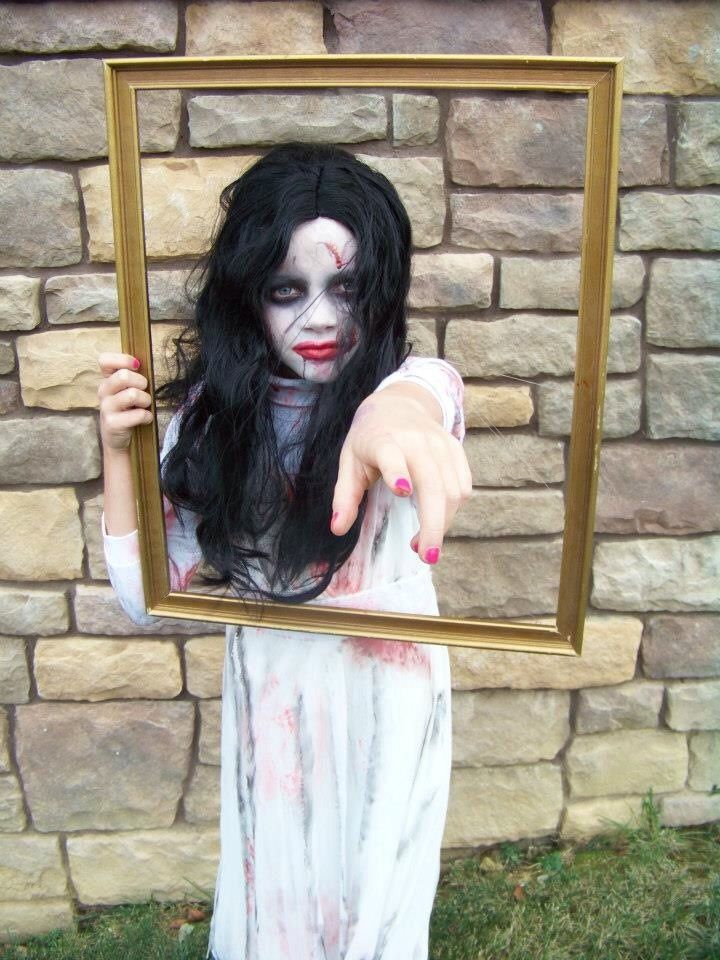 Trinity's 2012 Halloween costume - Bloody Mary Homemade costume by me - dress bought at Goodwill & I ripped it up & used markers for 'blood' & also bought the frame for $.25 at Goodwill too.