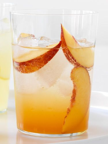 Two parts club soda, one part sweet apricot nectar, plus sliced nectarines to nibble. Another great idea: combine club soda with puréed watermelon. #drinks