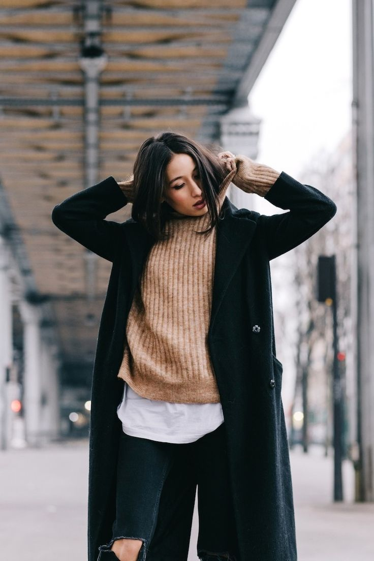 black coat, ribbed camel turtleneck, white tee and ripped black jeans