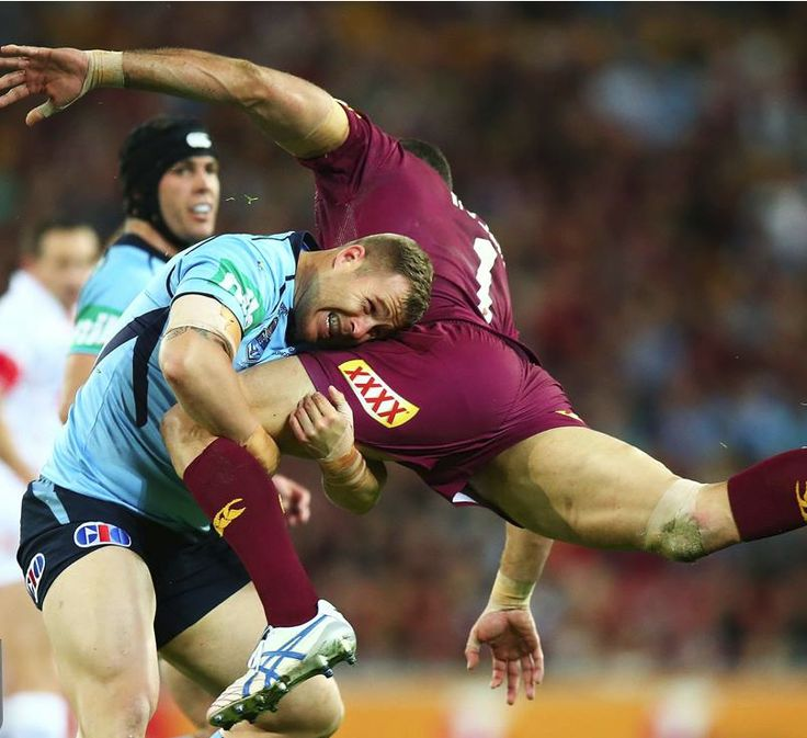 Trent Merrin of the New South Wales tackles Greg Inglis of the Melbourne Storms