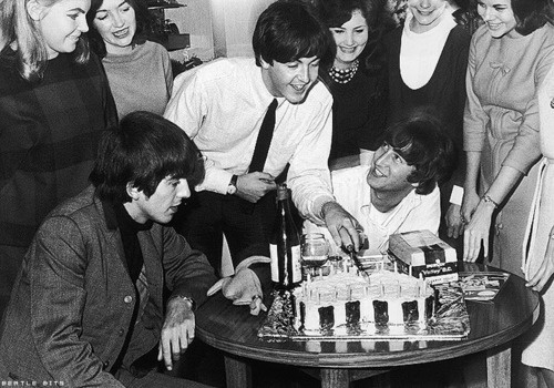 George sure is keeping his eyes on that cake.