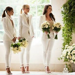 LOVE the bm's in suits. Brilliant. via @easonandboulos Image by @gmphotographics #alternativebride #bridesmaids #whitesuit