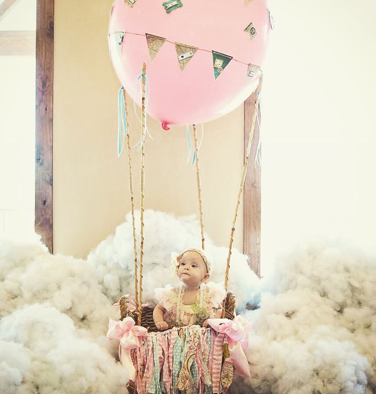 Paper mâché clouds and hot air balloon for the first birthday girl.