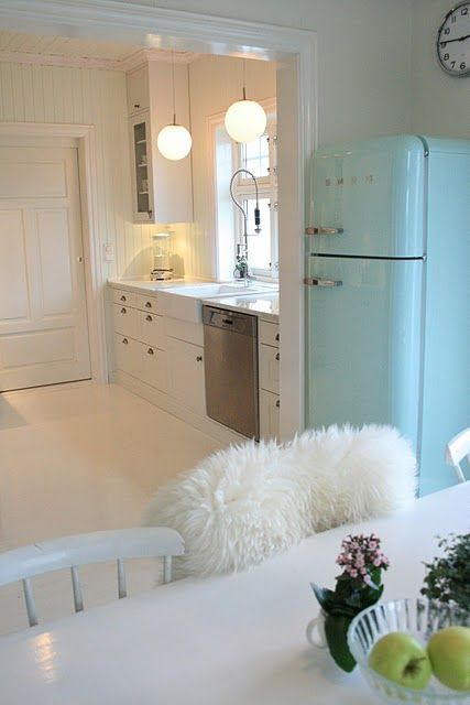 Gotta love a light blue smeg fridge.