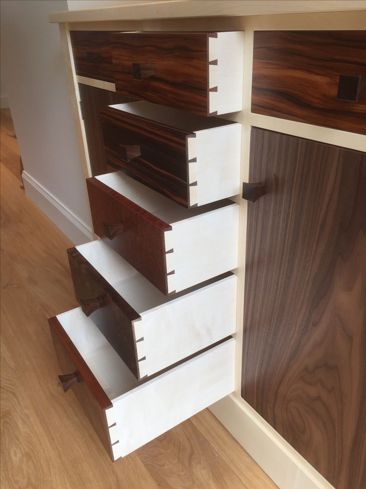The art of traditional drawer making. Hand cut dovetails sycamore drawer sides and dark highly figured drawer fronts