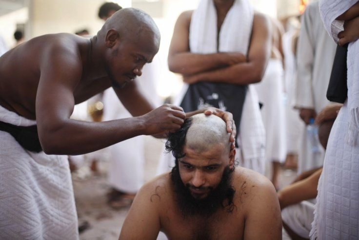 Hajj A Muslim pilgrim has his head shaved after casting pebbles at a pillar that symbolises SatanReuters