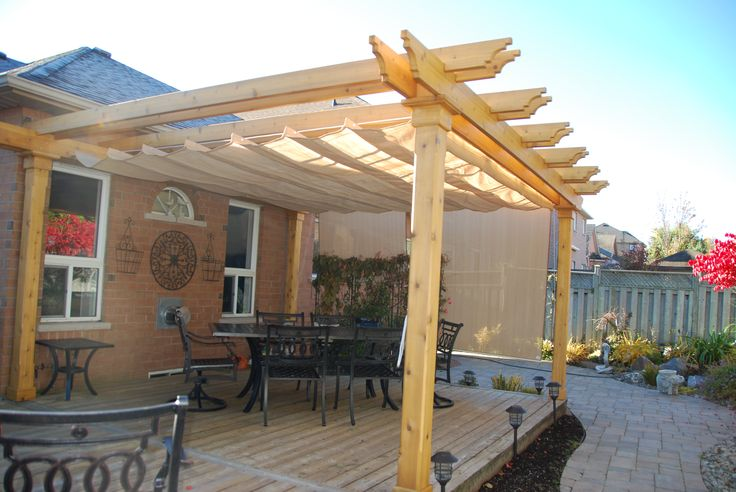 Colonial Pergola attached to deck. Added Nesling shade for sun protection on both top and side.