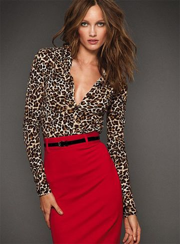 Leopard printed blouse with hot red skirt for business casual
