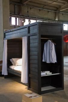 make it a bed uptop, desk underneath, and closet on side with doors to hide clutter... great all in one bedroom