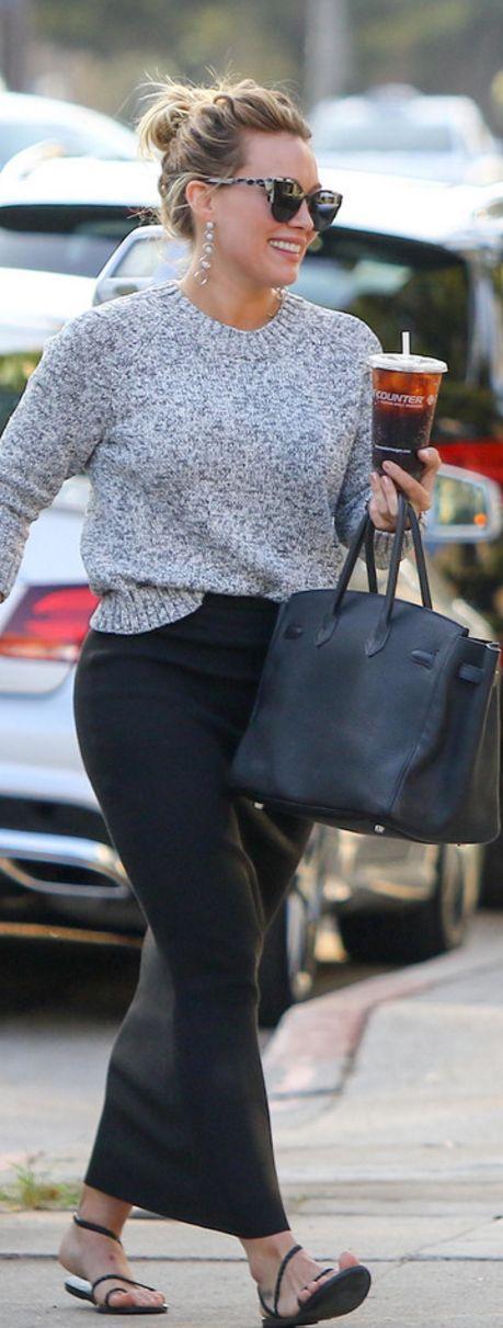 Who made  Hillary Duff's gray sunglasses, jewelry, black flat sandals, and handbag?