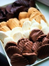 Chocolate covered potato chips    ingredients    1 cup semisweet chocolate pieces (6 ounces)  2 -3 teaspoons shortening  5 ounces ridged potato chips  directions    In a small heavy saucepan, melt the chocolate and shortening over low heat, stirring occasionally until the chocolate starts to melt. Immediately remove the chocolate from the heat and